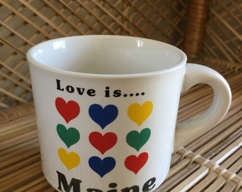 Vintage Love is ... Maine mug with rainbow hearts