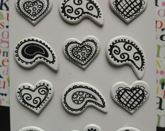 set of 12 Brads in the shape of heart and white and black Teardrop