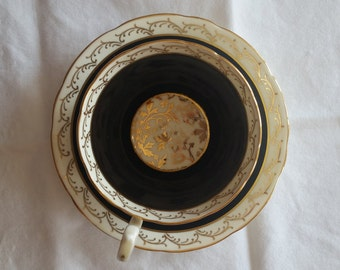 Aynsley black and gold teacup and saucer set - marked C341