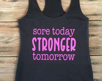 Sore today stronger tomorrow on a black racerback tank top