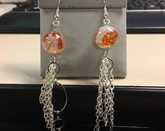 Orange and white tassel earrings