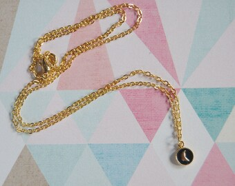 tiny crescent moon enameled gold plated charm necklace