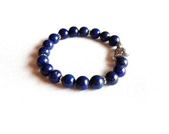 Dark blue bracelet with a buddha pendant