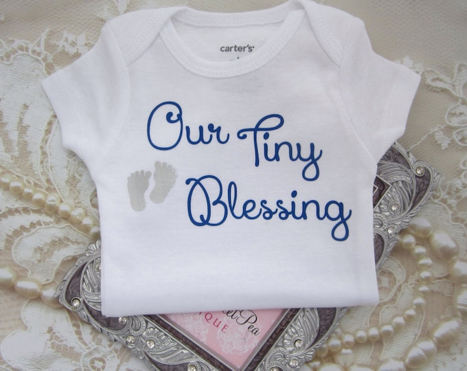 Our Boy's Tiny Blessing Bodysuit. Vinyl letters on White a Carter's one piece. Buy ONE for a baby shower gift. By Lil Miss Sweet Pea