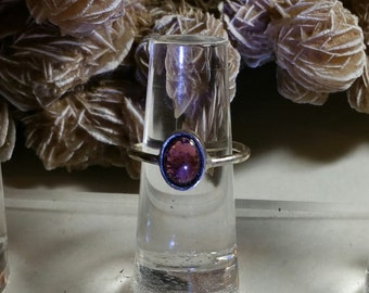 Garnet 2.5 carats in bezel on sterling silver band size 5 1/2. Item #R406