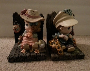 Little Boy and Girl Sitting in Yard Bookends