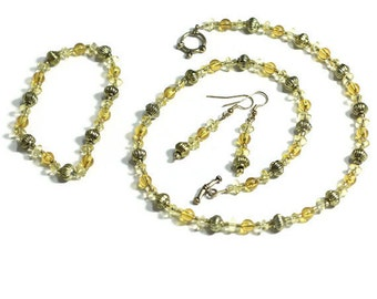 Gold toned jewelry set with necklace, earrings, and bracelet - beaded necklace with toggle clasp, earrings, and bracelet