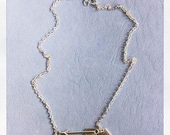 Arrow necklace with brave tag