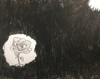 Heavy - A black charcoal drawing, beautiful rose with a little beam of light