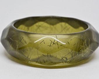 Lovely green plastic bangle bracelet