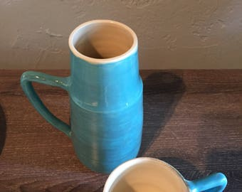 Turquoise water bottle and cup