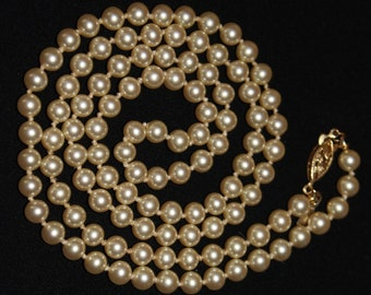 "Vintage Napier single strand creamy pearl necklace, 30 1/4"" long"