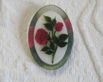 pink rose brooch . rose in lucite brooch . oval lucite brooch . 60s lucite brooch . reversed carved rose brooch