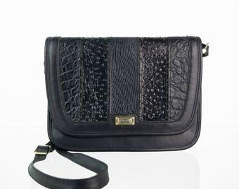 Dark blue vintage purse in patchwork style