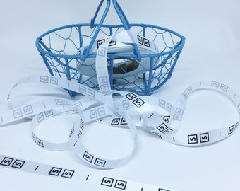 Labels sizes S, M and L Ribbon with approximately 250 tags