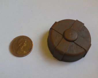 One sixth, or play scale, miniature model post-apocalyptic style landmine in rusty brown.