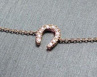 Horse shoe charm bracelet.