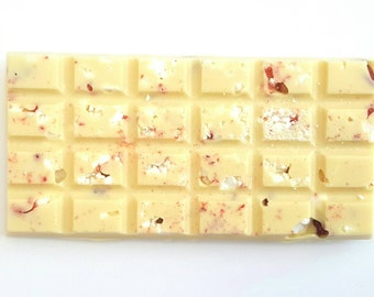 White chocolate bar loaded with strawberries and meringue