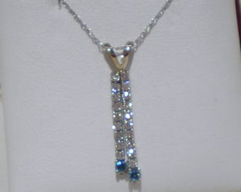 Necklace with blue and white diamond pendant