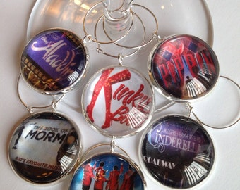 Broadway show wine glass charms featuring Pippen, Kinky Boots, The Book of Mormon, Jersey Boys, a perfect gift for the theater lover