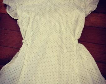 Lovely white cotton flutter sleeved dress.