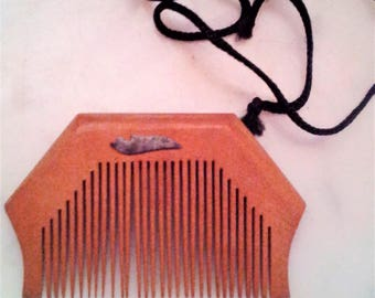 NEW ITEM! Vintage, hand carved Nepalese hair comb with hair string and some sort of metal inlay on both sides of comb.