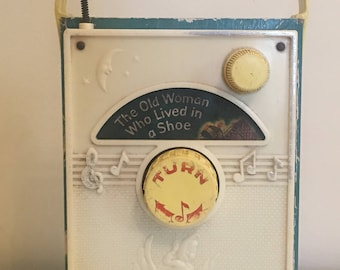 """Vintage Fisher Price Music Box, Pocket Radio Pop """"the old woman who lived in a shoe""""- sold and hand delivery- Do Not Buy This Item!"""