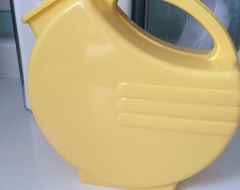 1950s Art Deco style Mid century modern Bright Yellow Plastic Pitcher with Flip Cover