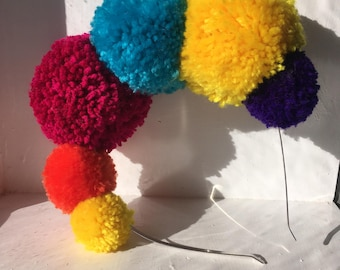 Party Pop! pom-pom headband with six lush pom-poms
