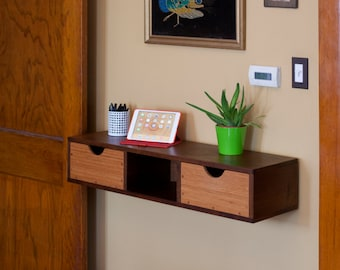 Walnut and bamboo wall-mounted shelf with drawers