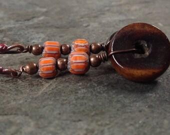 Bone, copper and ceramic