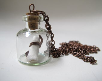 Secret message in a bottle. Necklace