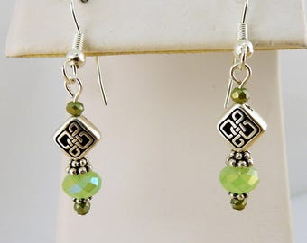 Dainty Silver Celtic Knot dangle earrings with green crystal beads
