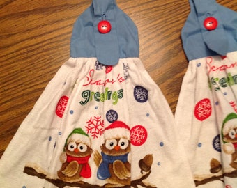 """Pair of Holiday Owls Hoot """"Seasons Greetings"""" on Hanging Towels with Red Button and Blue Hangers"""