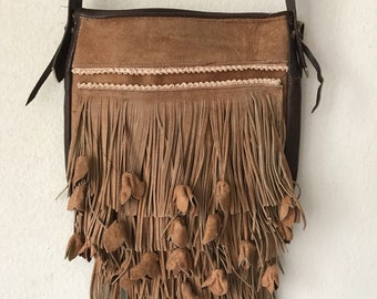 Brown hand made leather fringe bag size small .