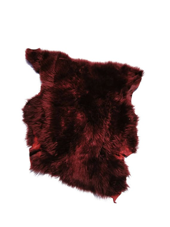 Beautiful burgundy single pieces of leather with fur. Different sizes and hair lenght. Prime quality!