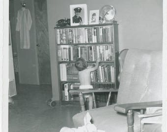 vintage photo 1960 Baby from Back in Diaper Looks at Books Library Soldier Dad in Frame