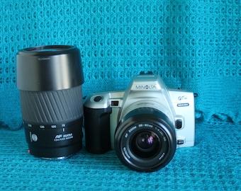 Minolta Maxxum QT si SLR 35mm camera-with 35-80mm, 75-300mm  AF Lens