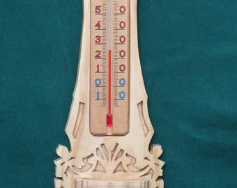 Thermometer inside solid wood cut for wall mounting