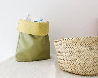 Storage basket and fabric and faux leather