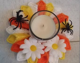 orange, yellow candle holder