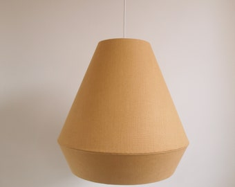 Shaped pendant lights made from fabric and hand stitched