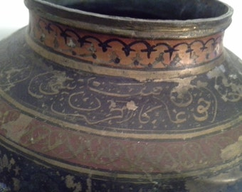 Bumps and scratches......but still pretty metal vase with great design