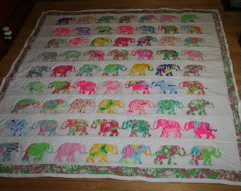 Queen size Elephant Parade quilt made with Lilly pulitzer fabric with 9 rows of Elephants