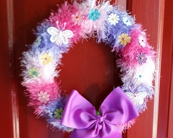 10 inch Spring wreath with embroidered flowers and a purple sating ribbon