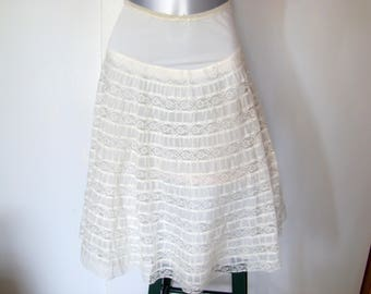"""Vintage 1950s flare half slip. Petticoat, skirt slip for a fiesta or rockabilly dress for a 27-28 inch waist, 24"""" from hip to hem."""