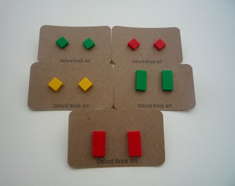 Red, yellow, green or gray shiny stud earrings made from Lego® square/rectangular pieces. Hypoallergenic surgical steel.