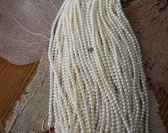 8-9mm #400 ringed semi rounds large hole freshwater pearls