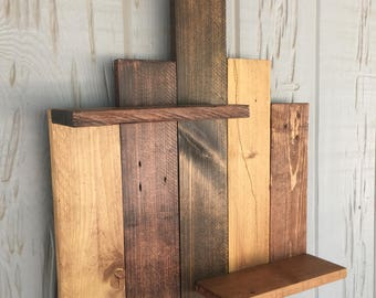 Rustic shelf made of reclaimed pallet wood.  Beautifully stained.  Sealed with polyurethane.