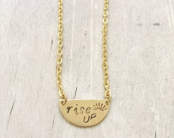 Hand stamped small half circle 'rise up' necklace. Proceeds to Planned Parenthood. Social change. Stronger together. Inspire.